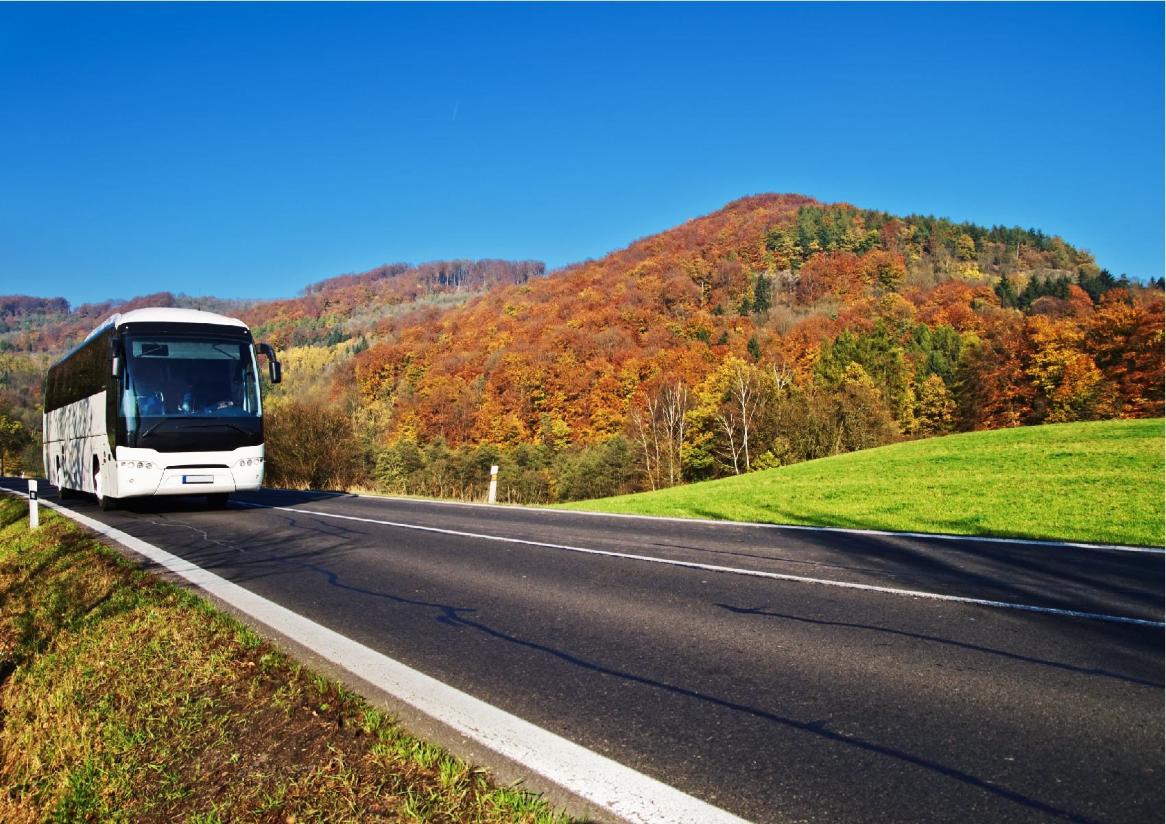 Group motorcoach entering Cherokee in the fall.