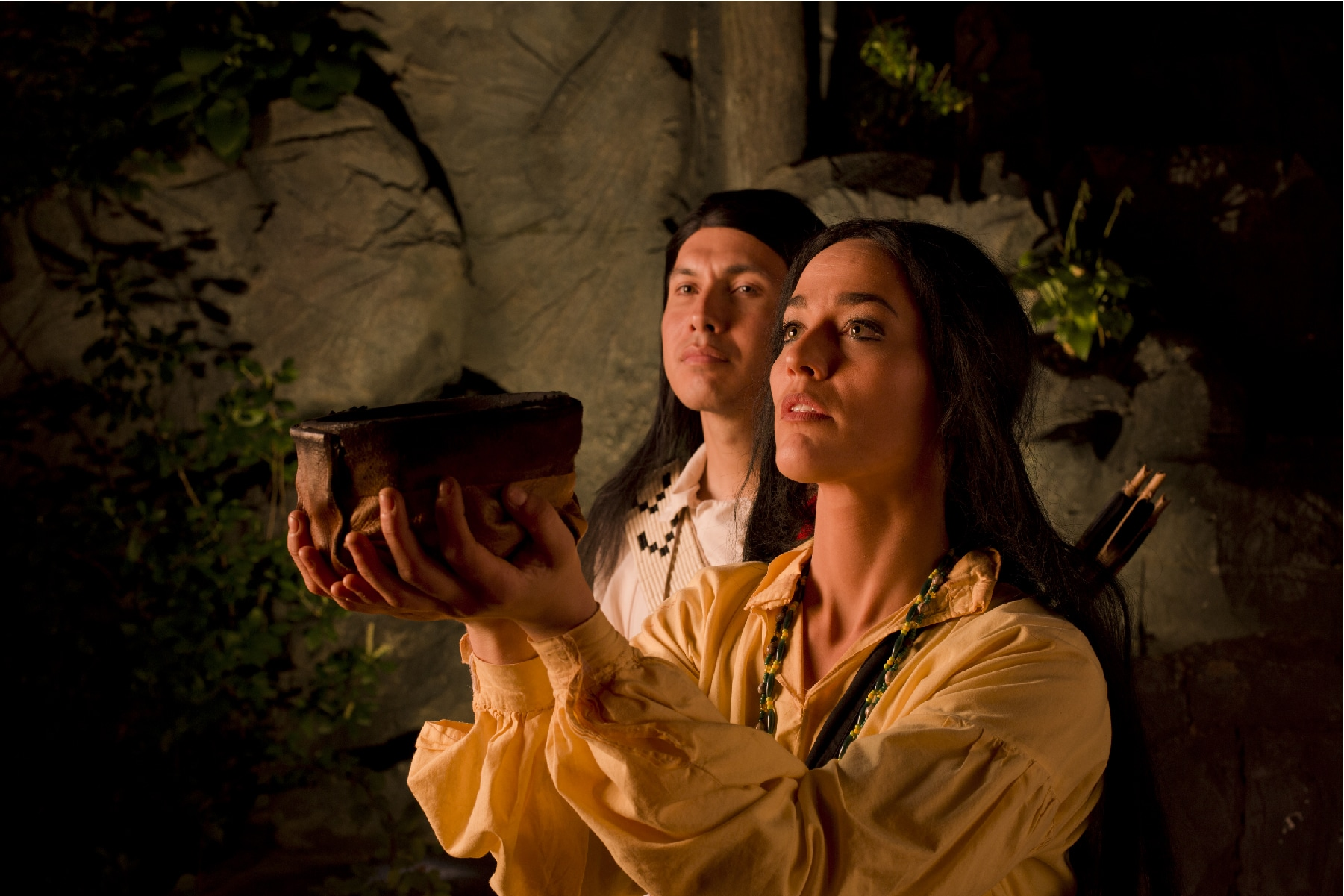 Cherokee male and female holding a traditional fire bowl